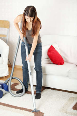 clean  electric: House work,young beautiful woman with vacuum cleaner at home. Housework concept