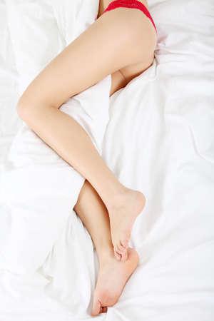 bedlinen: Woman legs on the bed