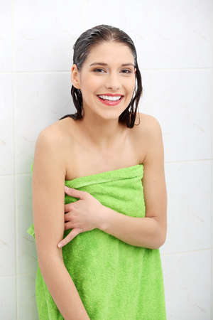 hand towel: Beautiful woman wipes her wet body with a towel at bathroom