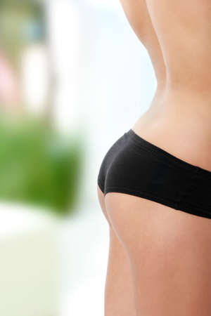 Perfect shape of womans buttocks  photo