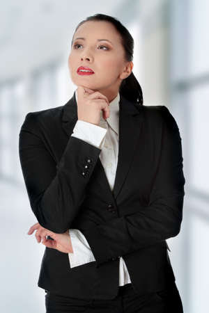 Thoughtful young caucasian businesswoman at office photo