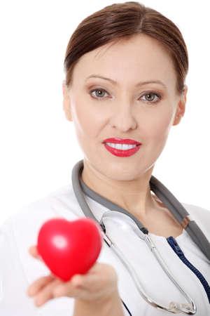 Dottore femmina adulta con il cuore in mano. Isolated on white Archivio Fotografico - 9248805