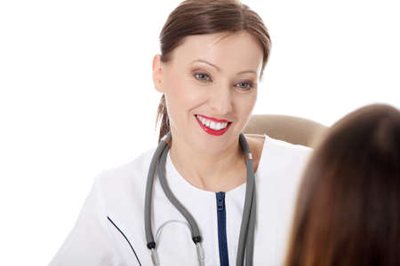 Mature smiling female doctor with her female patient. Isolated on white Stock Photo - 9248800