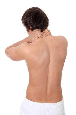 Young man heaving back pain. Isolated on white background  photo