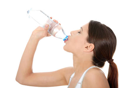 sport clothes: Beautiful young woman in sport clothes with bottle of mineral water  Stock Photo