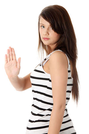 showed: Hold on, Stop gesture showed by young teen woman hand. Isolated on white