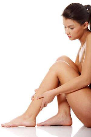 Injury. Woman holding on leg.  photo