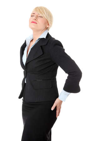 Mature business woman with backpain. Isolated on white background. photo