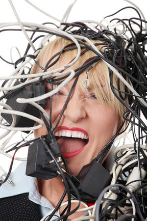 Mature businesswomans screaming in cables. Isolated on white background. photo