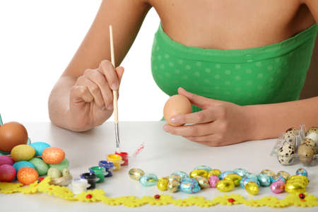 Young girl is making easter decoration  photo