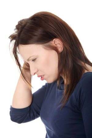 Woman with headache holding her hand to the head.  photo