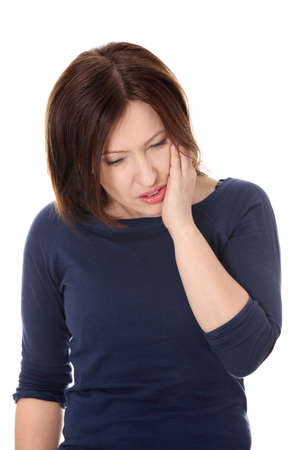 Attractive woman in her 40s pressing her bruised cheek with a painful expression as if shes having a terrible tooth ache.  photo