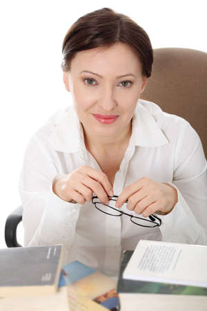 Mature student woman is learning at the desk photo
