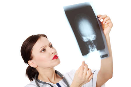 Mature female doctor looking at x-ray photo