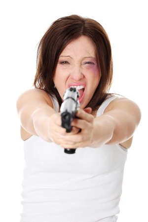 Abused woman revange - mature woman with hand gun photo