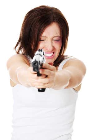 beat women: Abused woman revange - mature woman with hand gun Stock Photo
