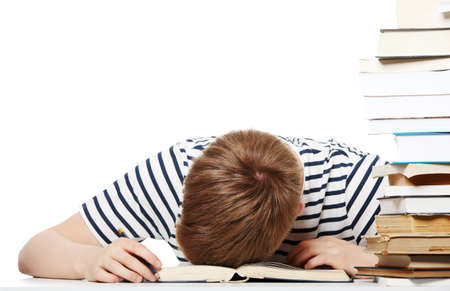 fedup: Tired student at the desk, isolated on white