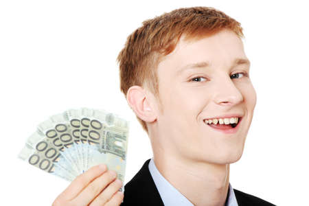 Young handsome businessman holding euros money. Isolated on white background. photo