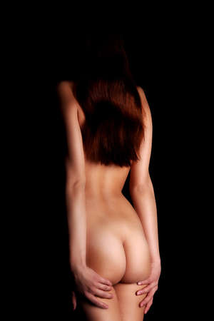 Young naked woman from behind, isolated on black Stock Photo - 10601552