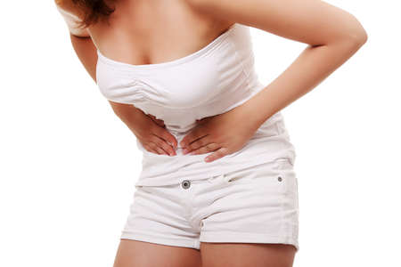 cramping: Woman with stomach issues isolated on white background Stock Photo