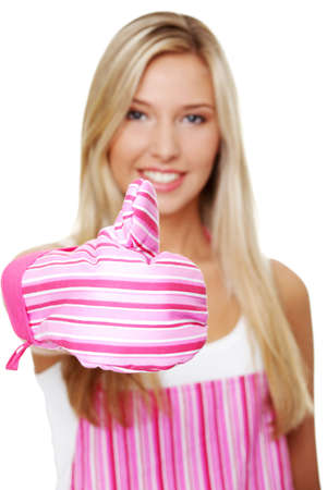 Beautiful happy young blond woman wearing kitchen apron and gesturing thumbs up, isolated on white Stock Photo - 10822445