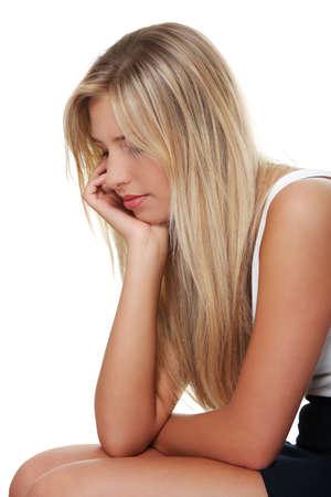 persona deprimida: Deprimida joven aislada sobre fondo blanco Foto de archivo