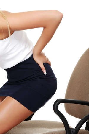 Business woman with back pain after long work on chair. Isolated on white background  photo