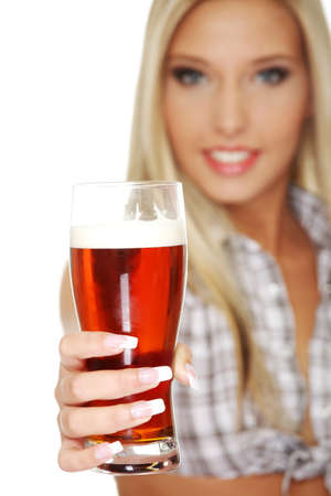 Beautiful and sexy young blond smiling woman giving beer, isolated on white photo