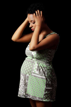upset stomach: Depression and stress of young pregnant woman against black background