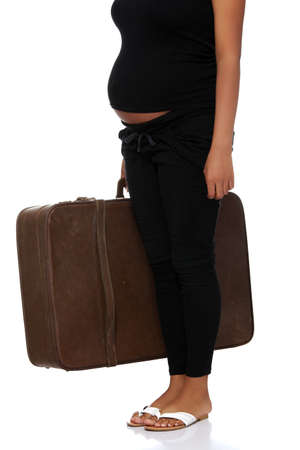 Pregnant woman with old suitcase, isolated on white photo