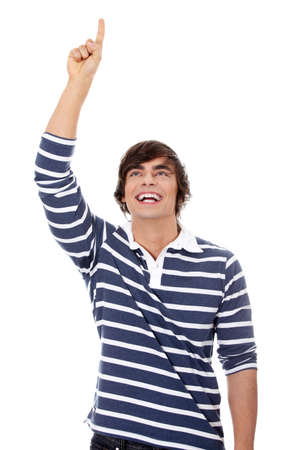man pointing up: Young happy handsome man pointing up with his finger