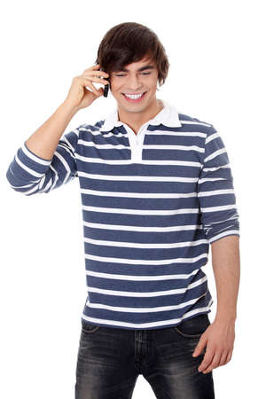 Handsome caucasian man makes a call on his mobile phone  photo