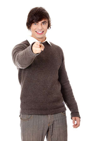 Young happy handsome man pointing on you, isolated on white photo