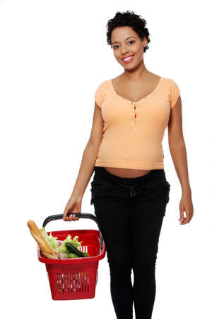 Pregnant woman with shopping basket, isolated on white  photo