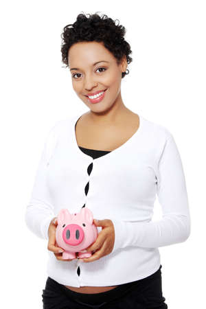 Happy pregnant woman holding piggy bank , isolated on white background  photo