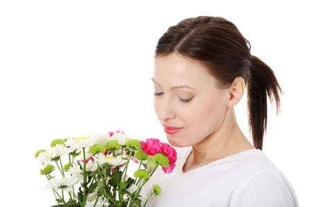 Beautiful caucasian women smelling her garland of flowers. Isolated on white photo