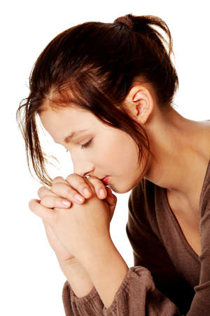 Young pretty caucasian girl praying over white background. photo