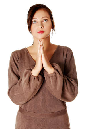 young pretty caucasian girl standing and praying. Isoalted on white. Stock Photo - 11253891