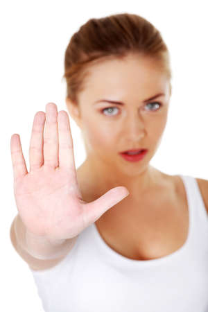 rejected: Young pretty caucasian girl showing stop gesture over white background.