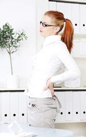 Businesswoman in the office having backache. Stock Photo - 11253991