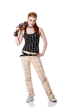 Teen pretty punk girl standing and holding fiddle on her arm. Isolated on white. photo