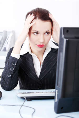 Beautiful pretty caucasian businesswoman having headache and sitting in the office. photo