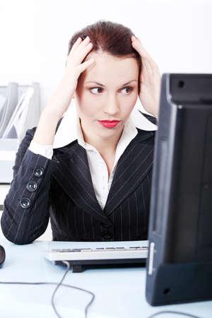 Beautiful pretty caucasian businesswoman having headache and sitting in the office. photo
