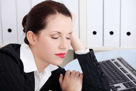 Beautiful caucasian businesswoman sleeping in the office. photo