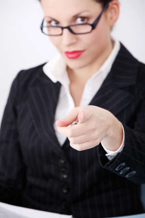 Pretty caucasian businesswoman pointing on you. photo