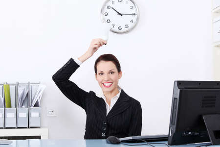 Pretty caucasian businesswoman holding a light bulb in the office. photo