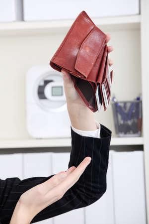 Closeup on empty wallet in caucasian woman`s hands. photo