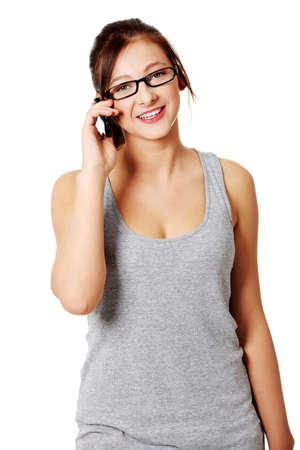 Young caucasian beautiful girl talking by telephone and smiling Stock Photo - 11254225