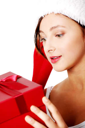 Closeup on teen pretty caucasian girl holding a gift over white. photo