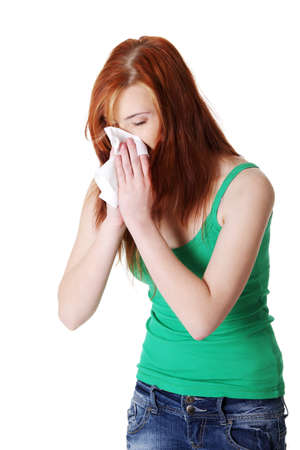 hanky: Teen pretty caucasian standing girl blowing her nose. Isolated on white. Stock Photo